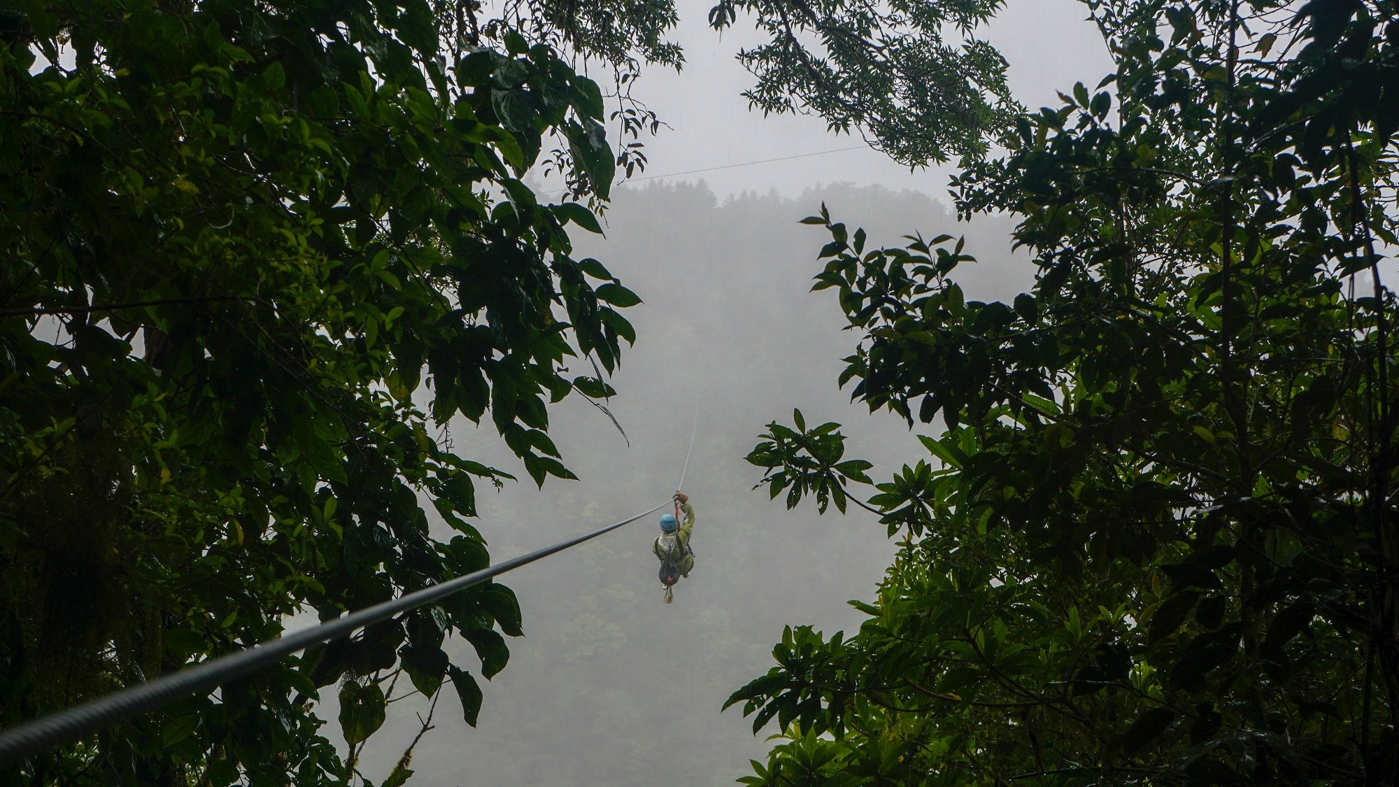 Ziplining During The Zipline, Atv, And Waterfalls Experience From Vista Los Suenos Aventure Park