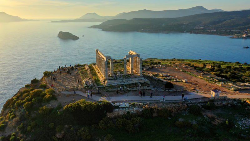 Enjoy A Glass Of Local Wine Watching The Breathtaking Sunset From Cape Sounio On The Sunset Cape Sounio Tour From Athens