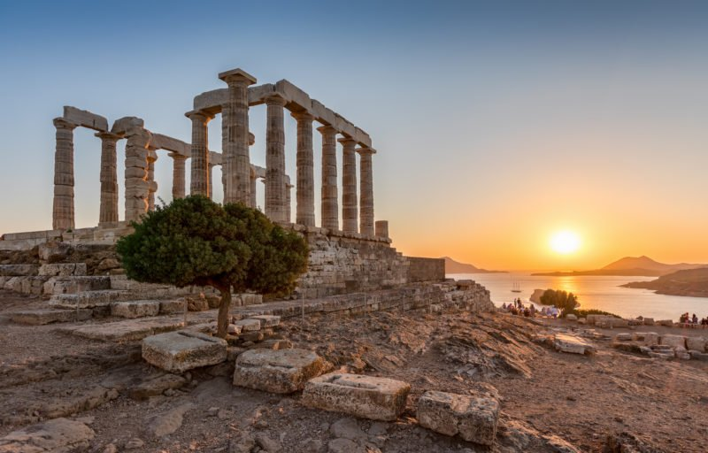 Explore The Temple Of Poseidon At Cape Sounio During Sunset