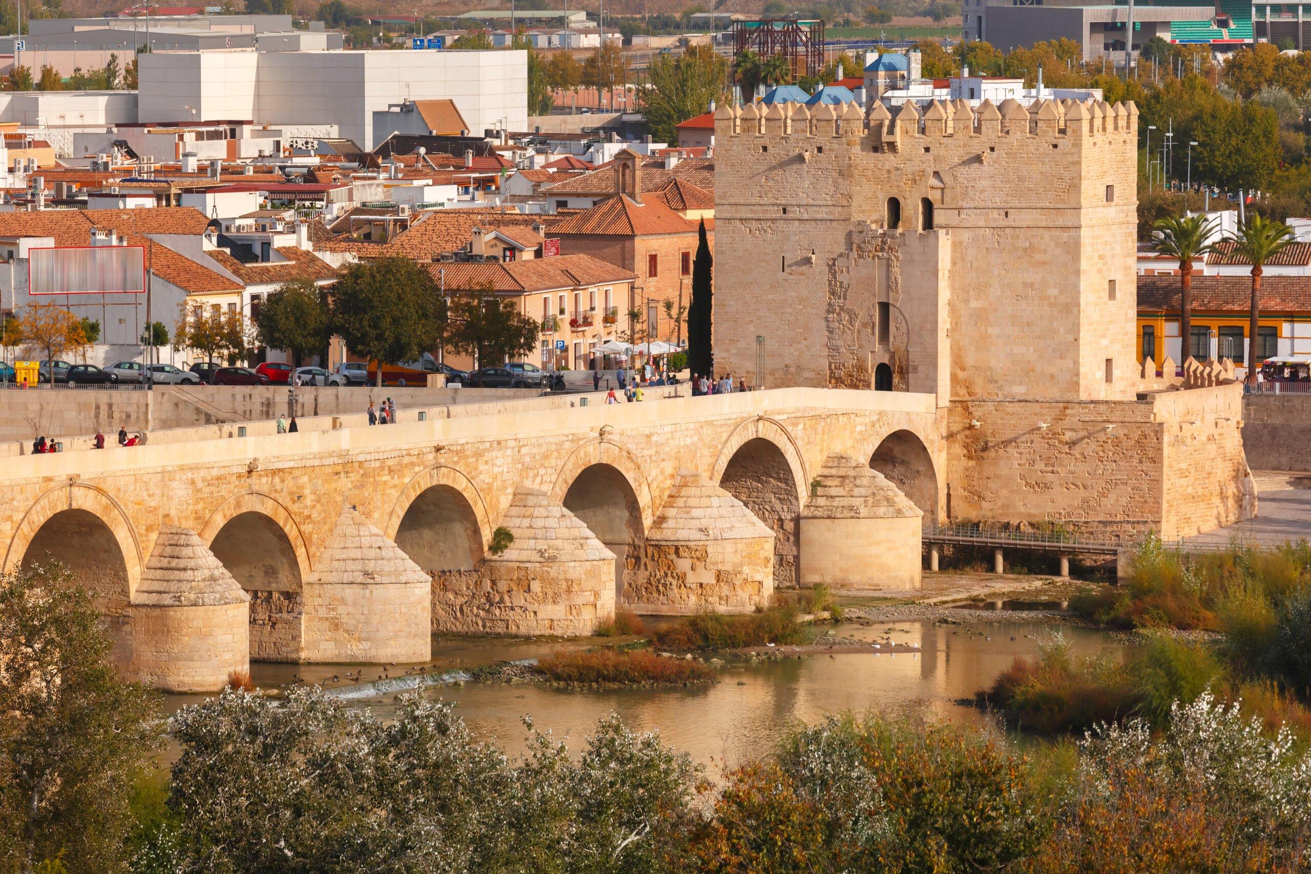 Admire The Roman Bridge Over The Guadalquivir River On The Cordoba Tour From Granada
