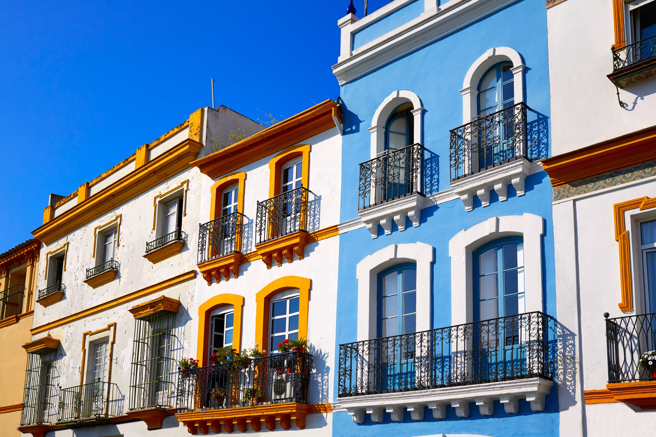 Admire The Colorful Facades Of Triana On The Tapas And Flamenco Experience In Seville