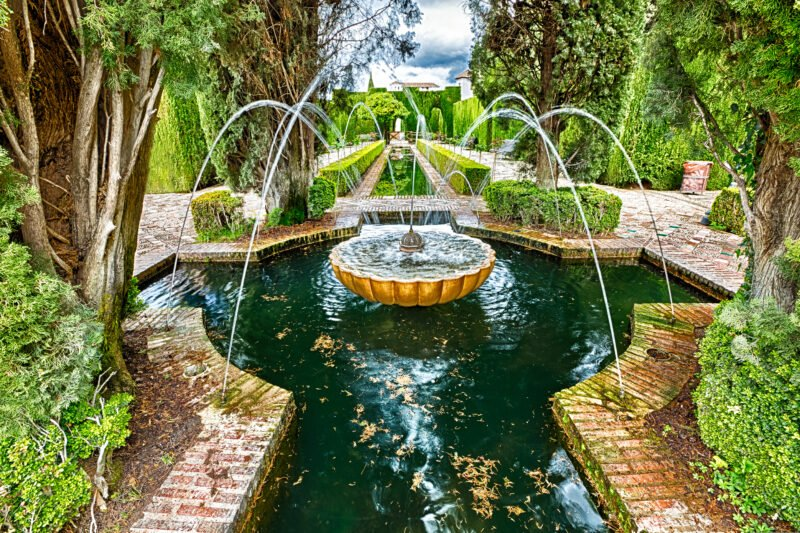 Stroll Trhough The Quiet Gardens On The Granada Tour From Seville
