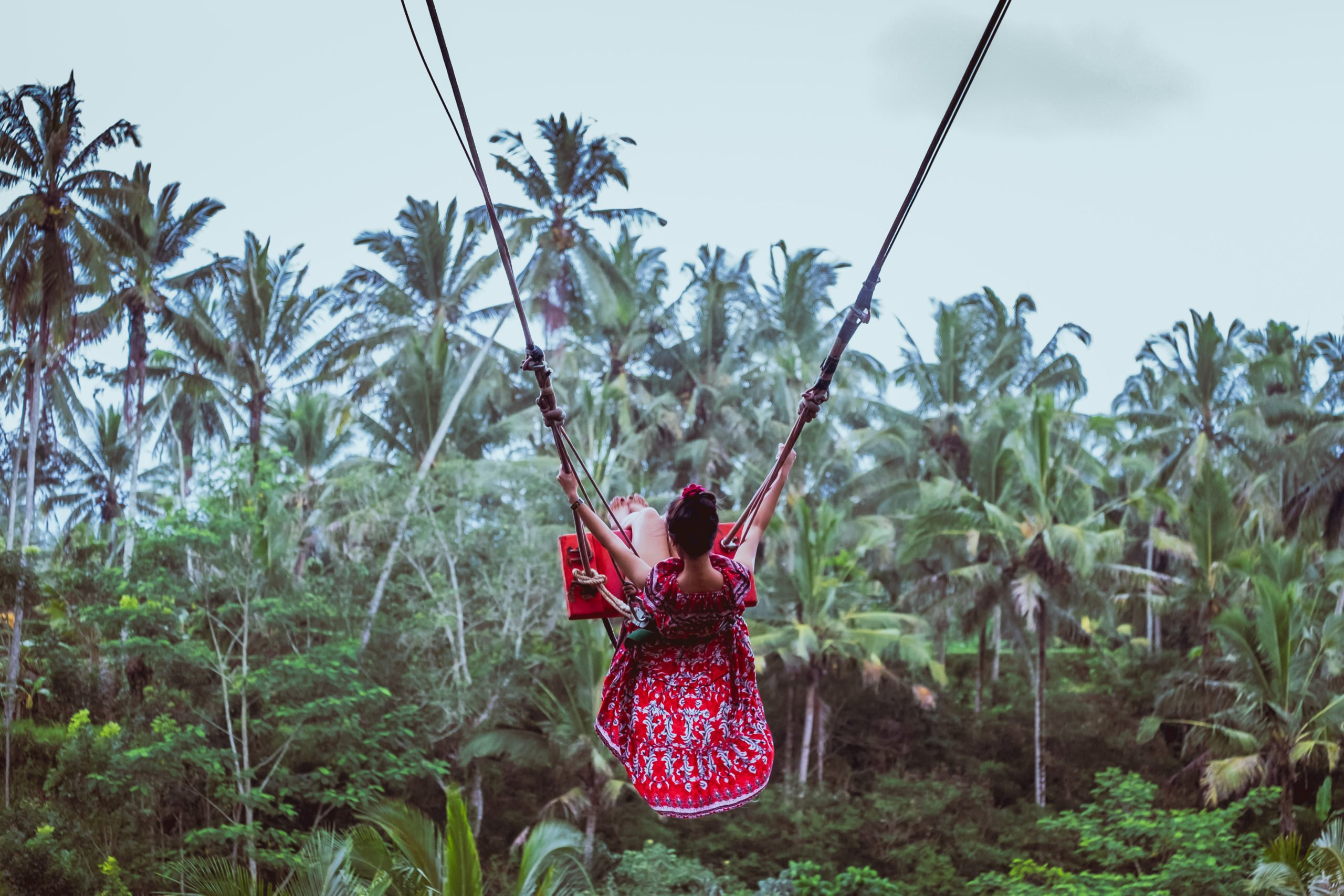 Swing Over The Rice Fields During The Ubud Wild Water Rafting & Kintamani Volcano Tour