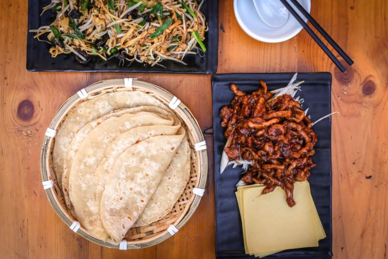 Roll Authentic Fillings Into Beijing's Famous Pancakes And Learn Where This Tradition Started In Our Beijing Evening Hutong Food Tour