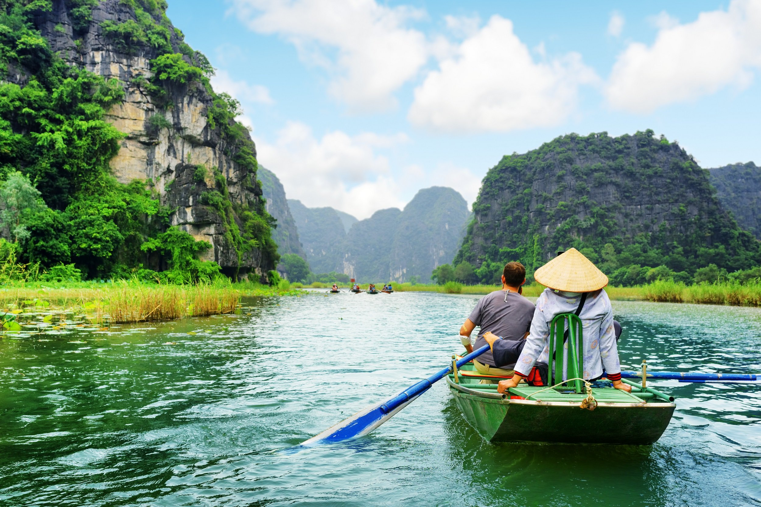 Take A Boat Ride On The Ngo Dong River On The Ninh Binh, Tam Coc, Dancing Cave & Hoa Lu Tour From Hanoi