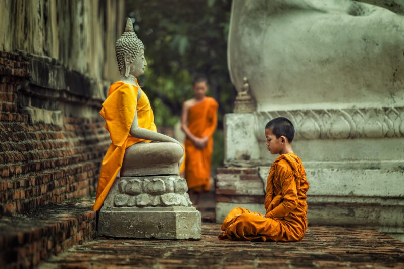 Novices Monk Vipassana Meditation At Front Of Buddha Statue In Our 8 Day Classic Tibet Tour