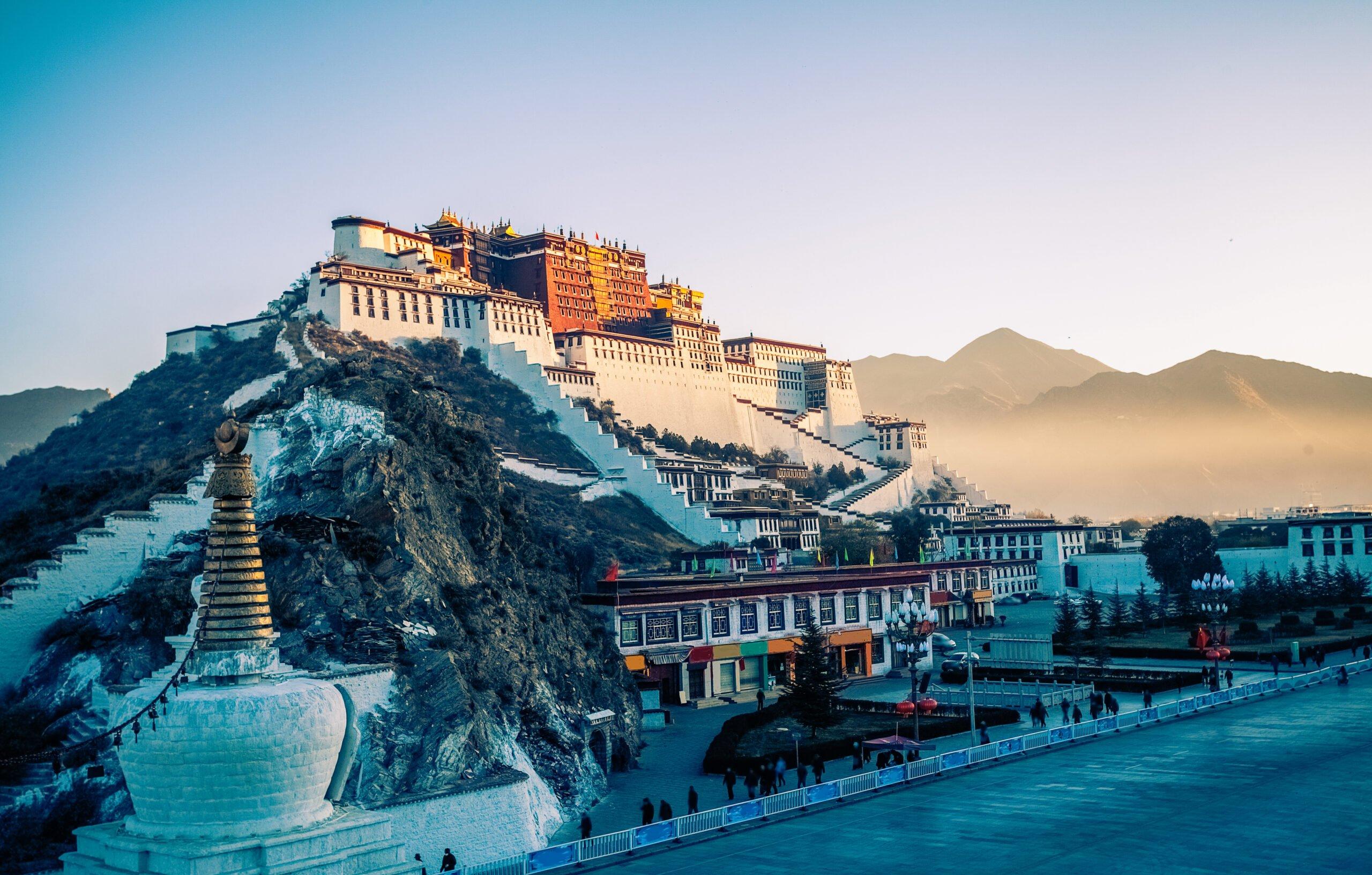 Potala Palace And Stupa At Dusk In Lhasa