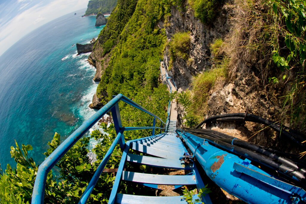 climb waterfall penida island