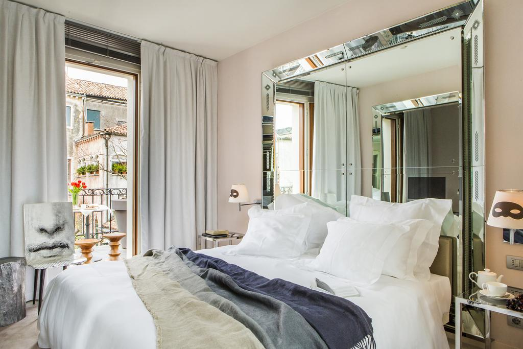Rooms at Palazzina Grassi, styled by Philippe Starck
