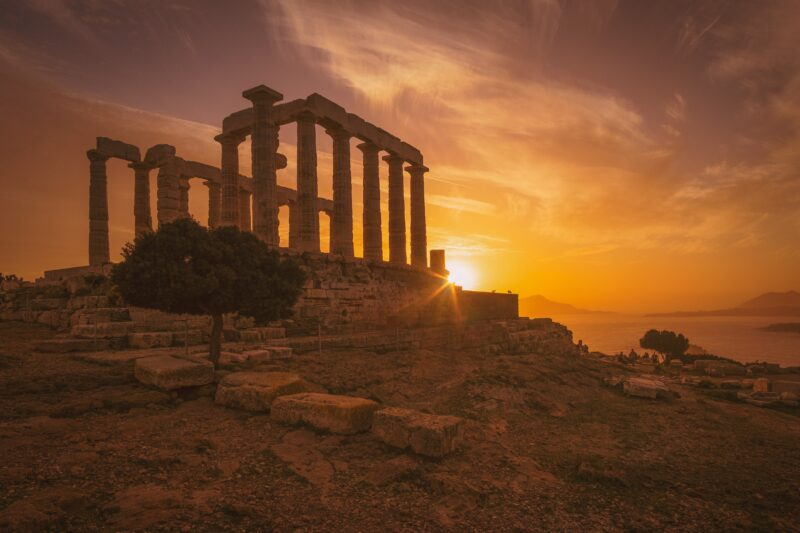 See The Sun Set Over The Temple Of Poseidon On Our 10 Day Athens, Santorini & Mykonos Package Tour